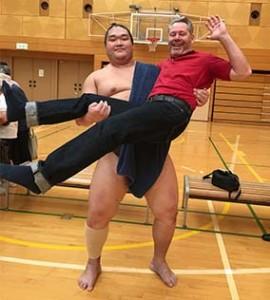 Brian held by Sumo wrestler
